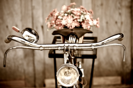 Old bicycle and flowers photo