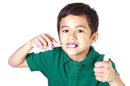 Boy und Zahnbürste Standard-Bild - 12392766
