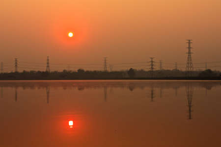 high voltage: Sunrise at lake Stock Photo
