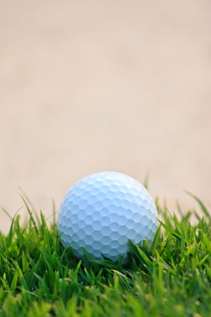 Golf ball  and sand bunker photo