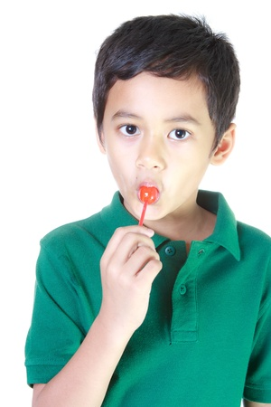 Boy eating candy Stock Photo - 12773060