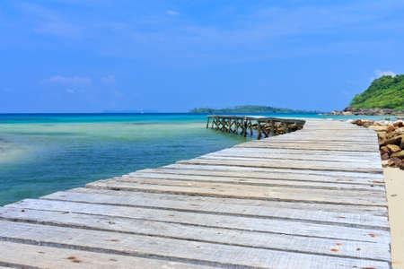 Wood jetty in Thai sea photo