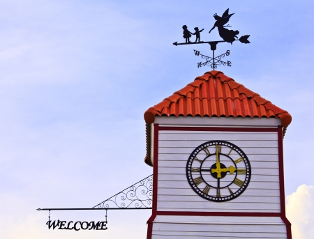 Angle and kids  - weathervane on the roof in blue sky Stock Photo - 13733118