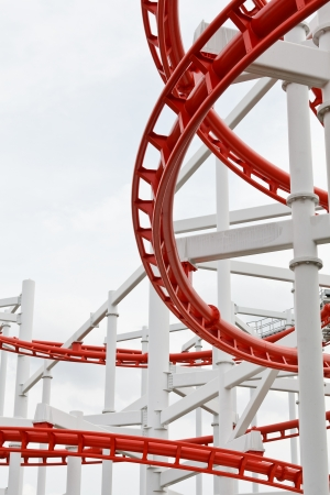 Line of red roller coaster rail photo