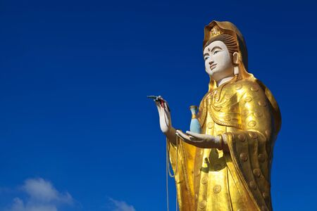supreme: Statue of supreme Chinese god and blue sky