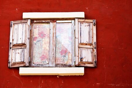 Wood window on vivid color wall photo