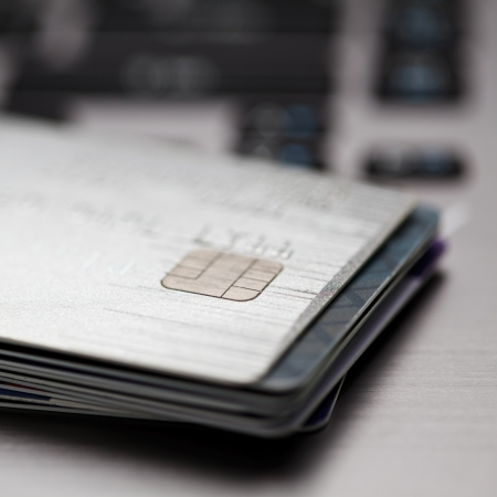 Close up shot of credit card and computer keyboard photo