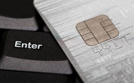 Close up shot of credit card and computer keyboard