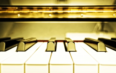 Piano keyboard in old style light photo