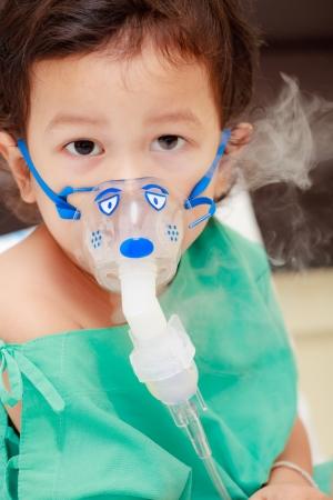 inhaler: Baby and medical mask on face