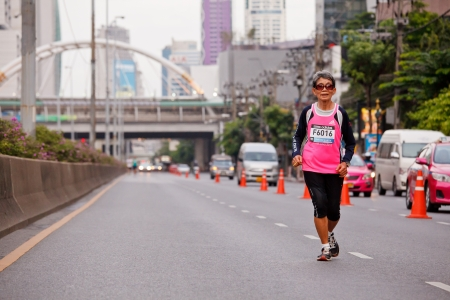 BANGKOK, THAILAND - JULY 29 : Unidentified  runner s on the street  during  Adidas King of the Road 2012  running championship on July 29, 2012 in Bangkok, Thailand.