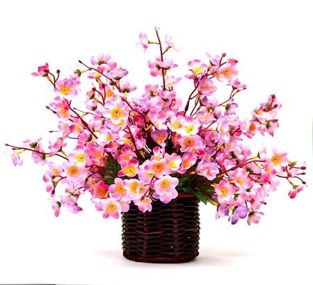 florero: Fake flores sobre fondo blanco