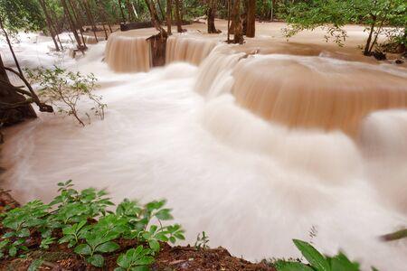 turbid: Turbid water waterfall in forest, west of Thailand Stock Photo