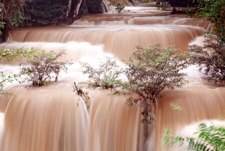 murky: Turbid water waterfall in forest, west of Thailand Stock Photo