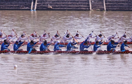 PIMAI, THAILAND - November  11  Unidentified rowers  in traditional Thai long boats compete during King