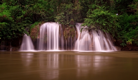 Waterfall in tropical forest, west of Thailand photo