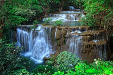 Waterfall in tropical forest, western Thailand Stock Photo
