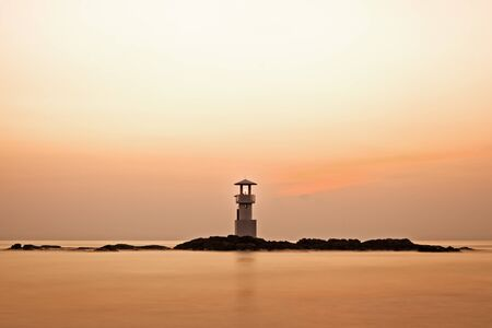 Colorful sky after sunset behide lighthouse photo