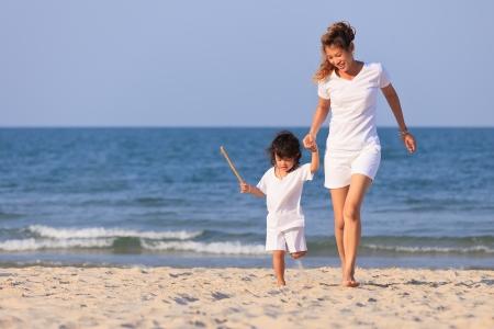 Asian family play on tropical beach