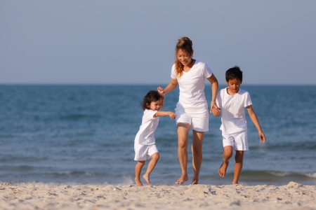 Asian family play on tropical beach