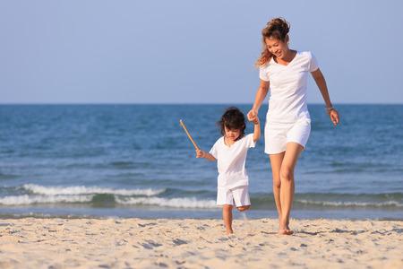 Asian family play on tropical beach photo