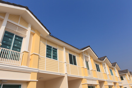 A row of new townhouses with colorful paint photo