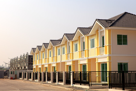 A row of new townhouses with colorful paint