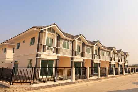 A row of new townhouses ready to sell Stock fotó