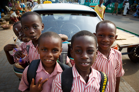 Group of African kids playing with camera Stock Photo - 27599815