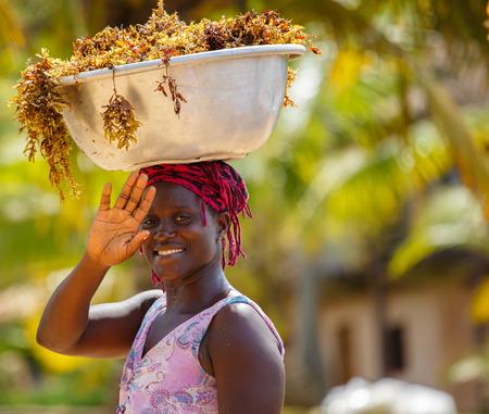 Genaral scene of African woman wiht things on head