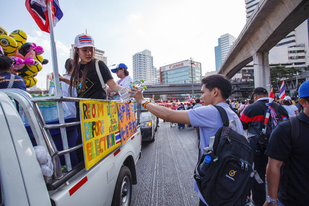 loyalist: BANGKOK-JAN 13: Unidentified Thai protestors give free drinking water to other protestors in mob that resistant to government of Shinawatra regimes on Jan 13, 2014 in Bangkok, Thailand.