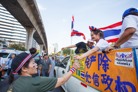 regimes: BANGKOK-JAN 13: Unidentified Thai protestors give free drinking water to other protestors in mob that resistant to government of Shinawatra regimes on Jan 13, 2014 in Bangkok, Thailand.