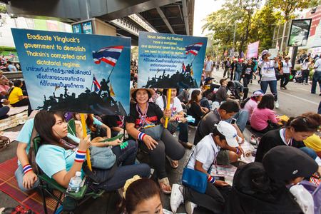 loyalist: BANGKOK-JAN 13: Unidentified Thai protesters raise banners to resist government of Shinawatra regimes on Jan 13, 2014 in Bangkok, Thailand. It claims that up to million Thai people gather on such day in the middle of Bangkok.