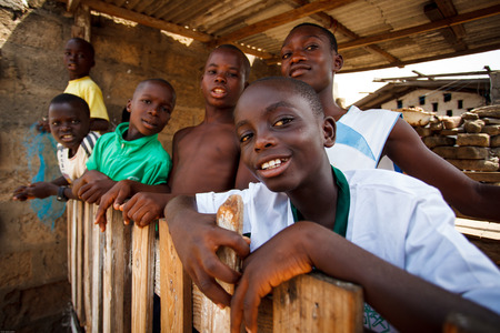 Group of African boys playing with camera Editorial