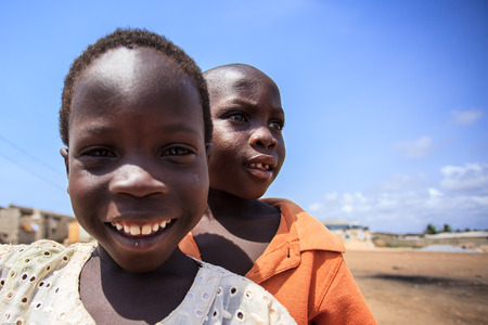 african village: Ghanaian boys with smiling face in blue sky background Editorial