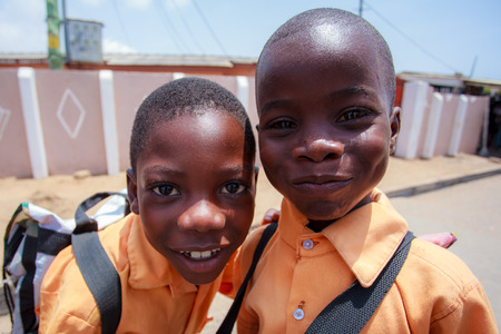 Faces of two young african boys with smiling