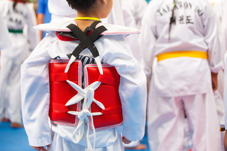 gym dress: Taekwondo athletes with with uniform and red armour