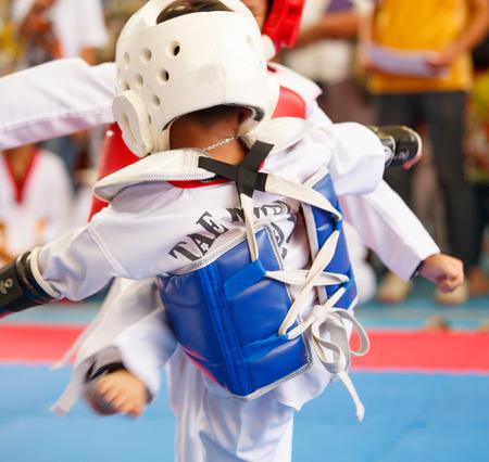 Kids fighting on stage during Taekwondo tournament 版權商用圖片