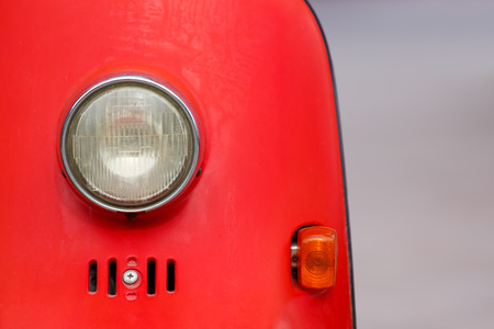 Vintage style motorcycle light with red body photo