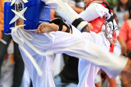karate boy: Young Taekwondo athletes are fighting during contest