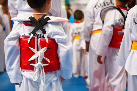 tae: Taekwondo athletes with with uniform and red armour