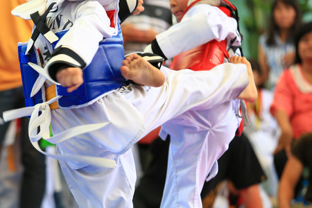 girl kick: Young Taekwondo athletes are fighting during contest