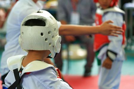 arts: Referee gives signal to young Taekwondo athletes