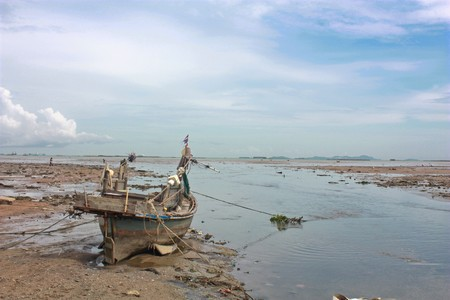 waited: Very old fishing boat on shore