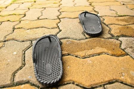 Black sandal on bricks