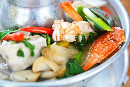 Sea food tum yum famous food in Thailand photo