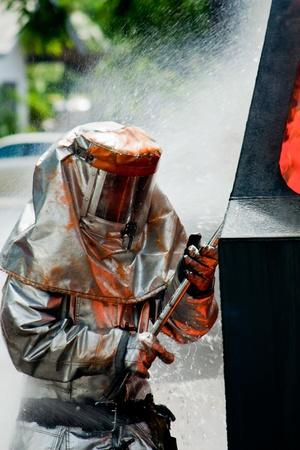 Fireman in firefighting suit photo
