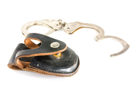 Handcuffs isolated on white background Stock Photo - 9515315