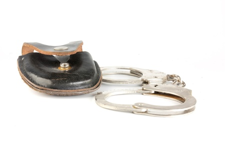 Handcuffs isolated on white background photo
