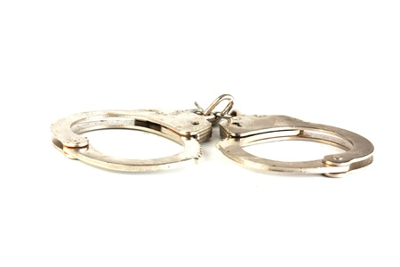 Handcuffs isolated on white background Stock Photo - 9515311